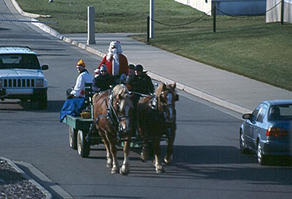 Papa Noel tirado por caballos